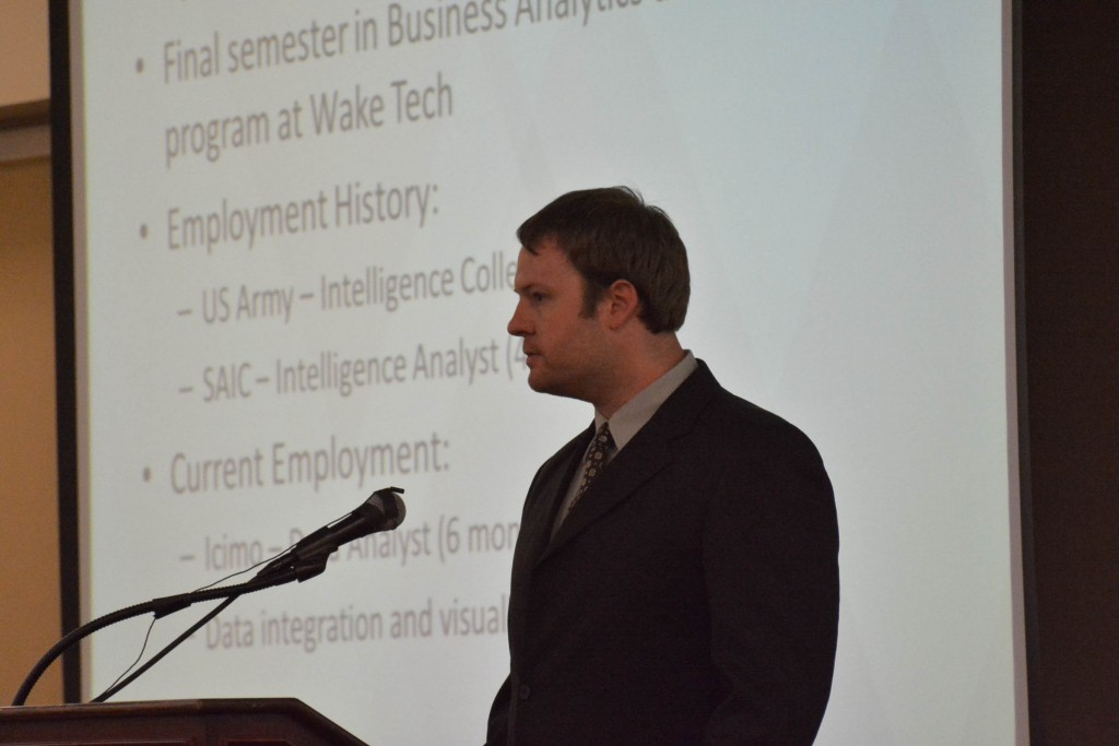 Business Analytics Student giving presentation during event