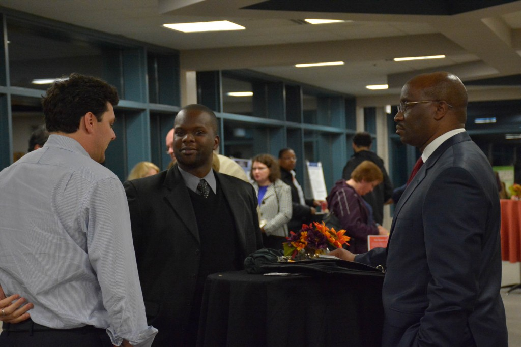 Business Analytics Students Networking with Industry Representatives
