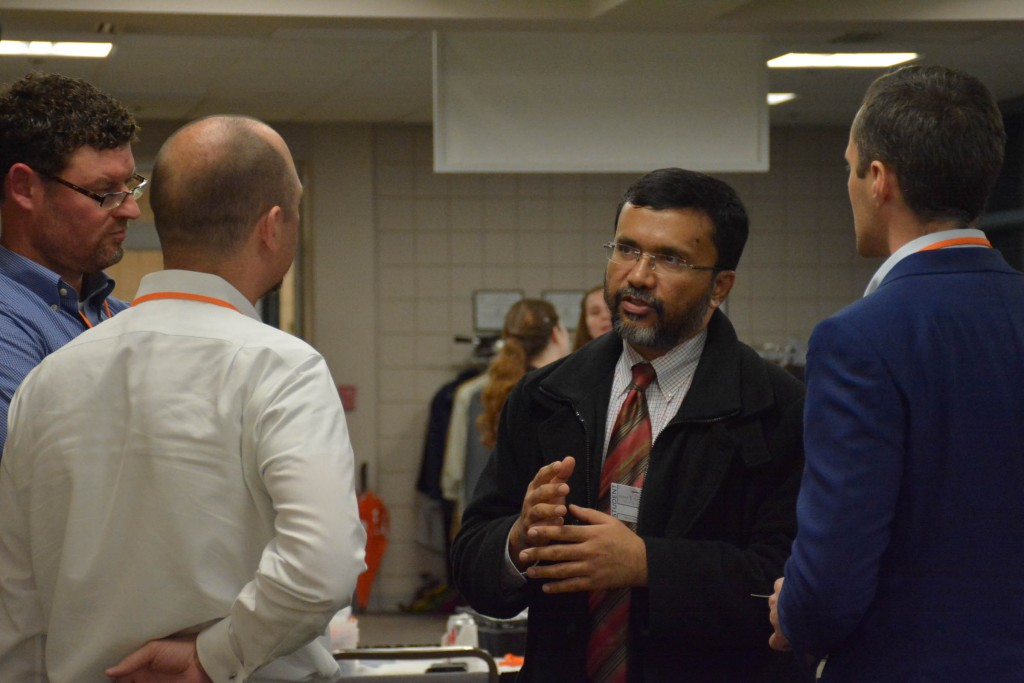 Group Engaged in Conversation at the Networking Event