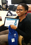 Sharron Rogers holding EPIC Certificate and Polo Shirt